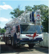 One of the many Crane and Boom Trucks offered by Collins Crane and Rigging Service